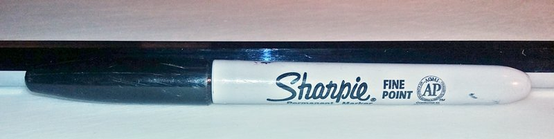 1/2 inch diameter spit rod next to sharpie