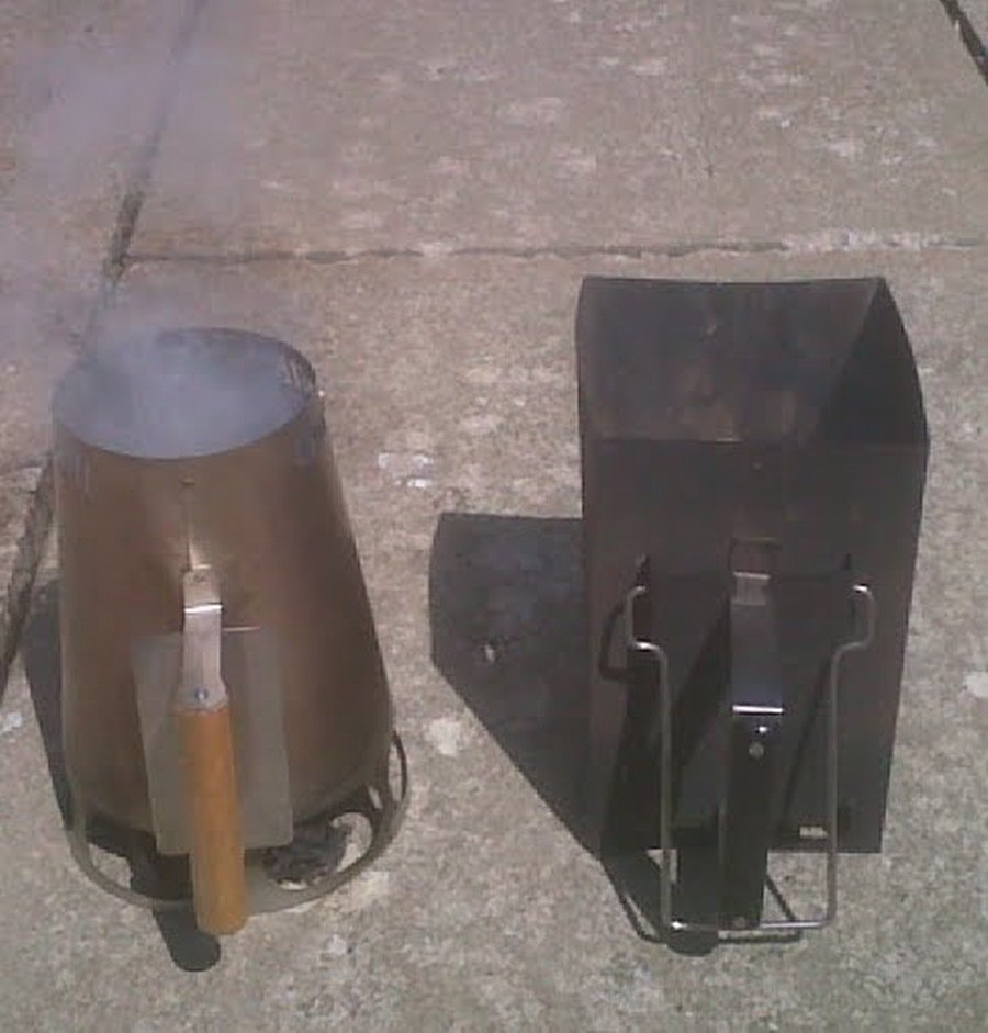 pair of charcoal chimney being lit