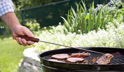 Long handle barbecue hook in use