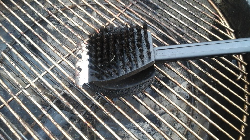 Dirty worn grill brush