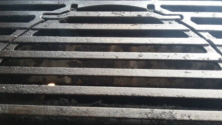 dirty porcelain coated grill grates after