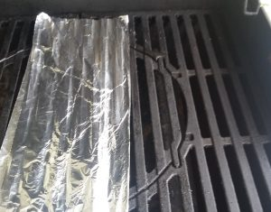 Foil skewer shield on gas grill