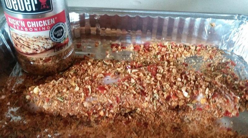 chicken tenderloin covered in Weber Kick'n Chicken seasoning