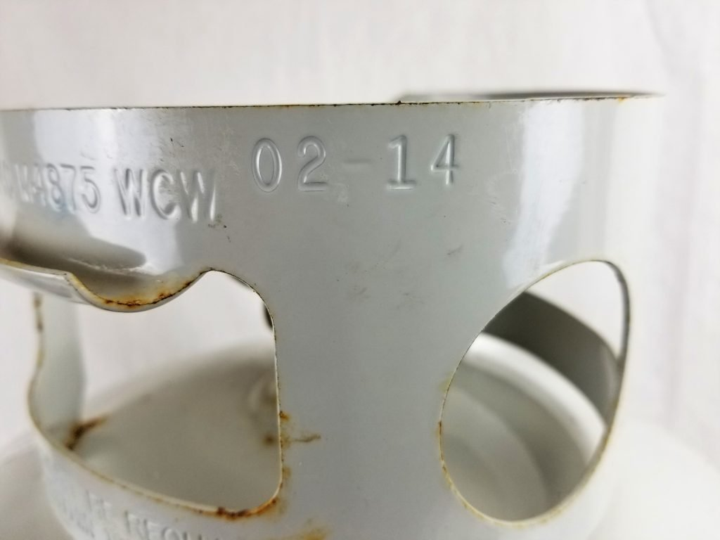 Manufacture date stamped on upper ring of 20lb propane tank