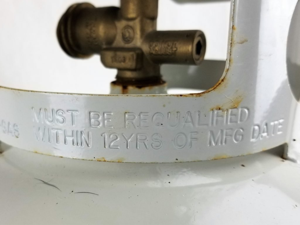 Warning of Expired 20 Pound Propane Tank stamped on ring
