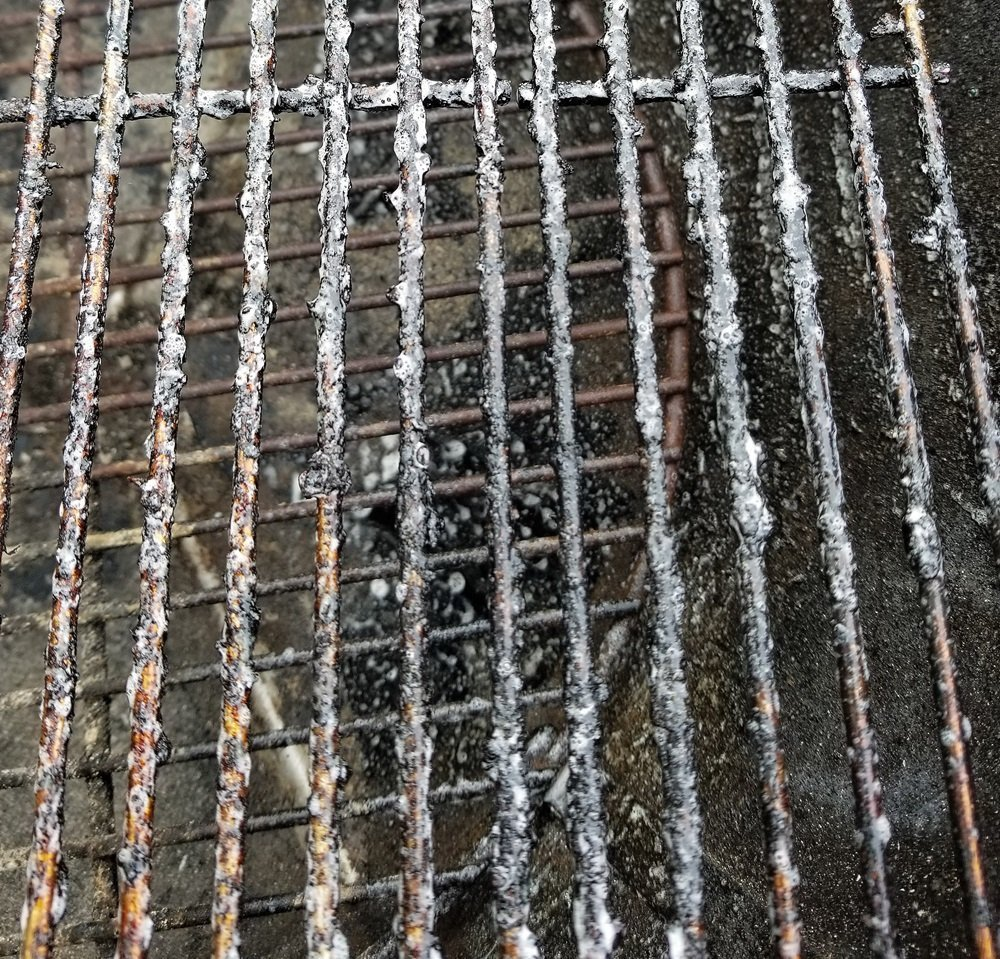dirty stainless grill grates with Weber grill grate cleaner applied