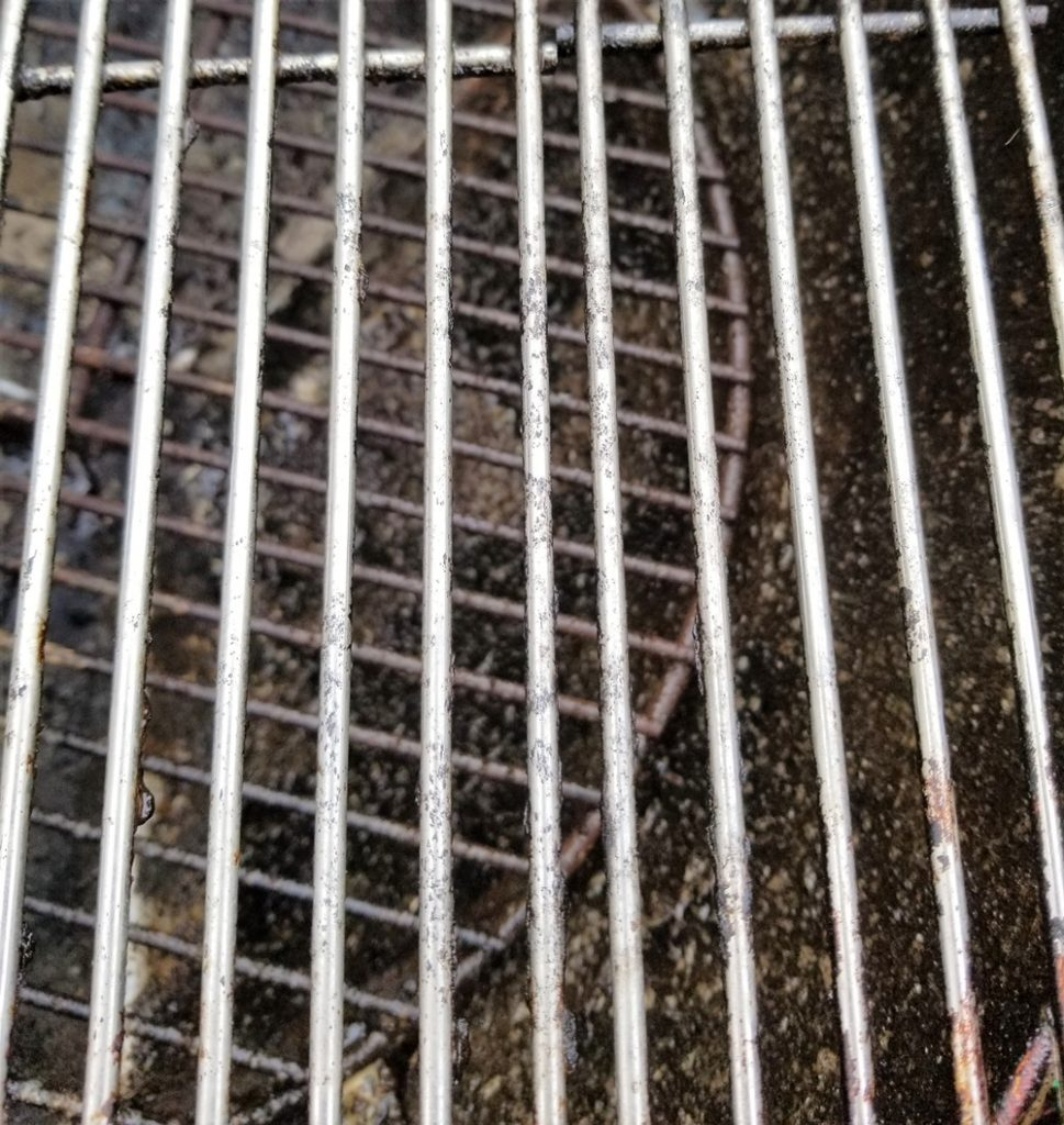 Stainless steel grill grates after being cleaned with Weber grill grate cleaner