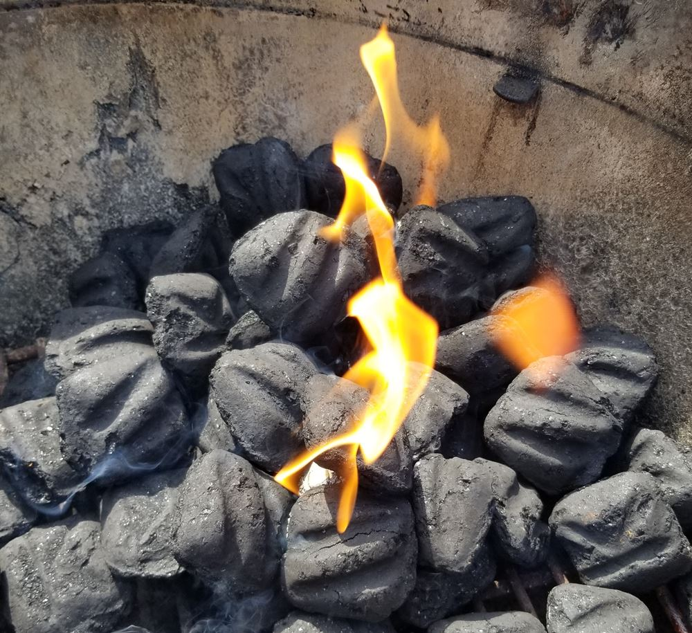 flames burning in lit charcoal